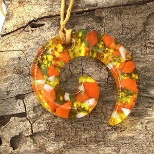 """Orange, yellow and a little green spiral 2.5"""" pendant with coordinating silk ribbon"""