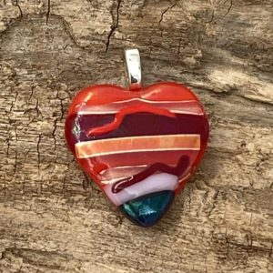 red heart pendant with red, red/orange, pink and black striped design