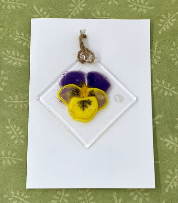 """Purple and yellow 3"""" square glass sun catcher attached to blank card hanging by corner"""