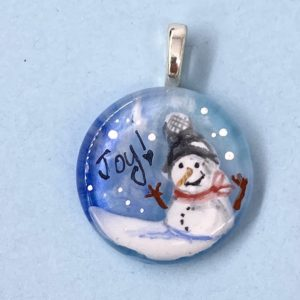 """Snow person on 1"""" pendant with red scarf and black hat"""