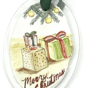 packages with Merry Christmas on an oval ornament