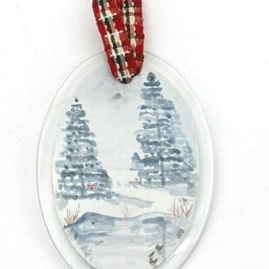 winter scene with pond and pine trees and tiny red cardinals