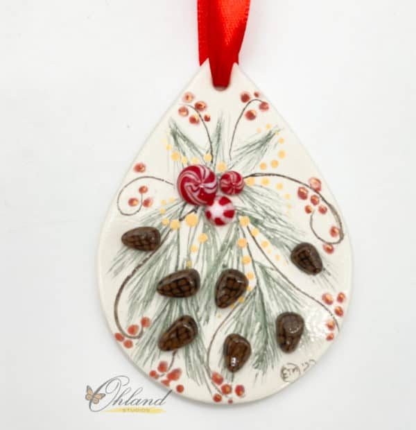 christmas ornament with hand painted pine spray, red berries, pine cones and peppermint decorations