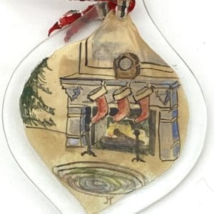 three stockings by a fire ornament