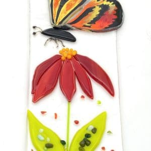 red yellow and orange butterfly over red flower sun catcher
