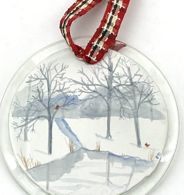 "blue and grey painted winter scene on a 3"" round ornament with cardinals"