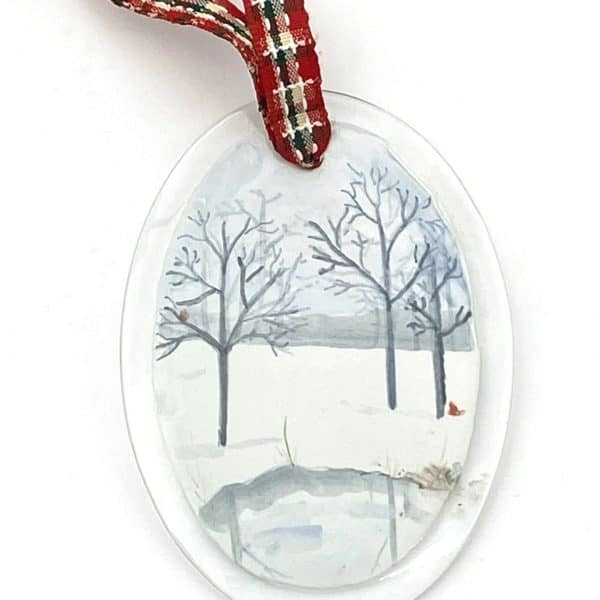 winter scene with branched trees, pond and cardinals
