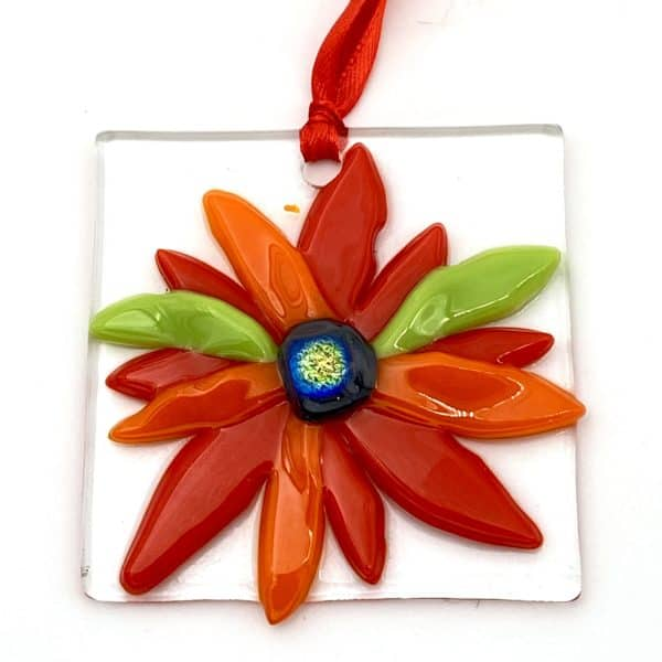 bright red and orange whimsical flower on a sun catcher