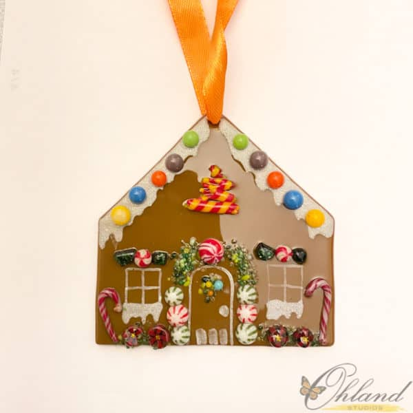 gingerbread ornament that is 3x3, mini mints, candy dots and candy canes adorn this little glass ornament